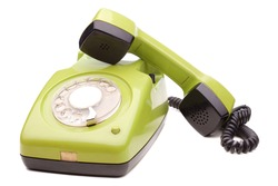 Green telephone retro style on white background. Vintage phone handset receiver.