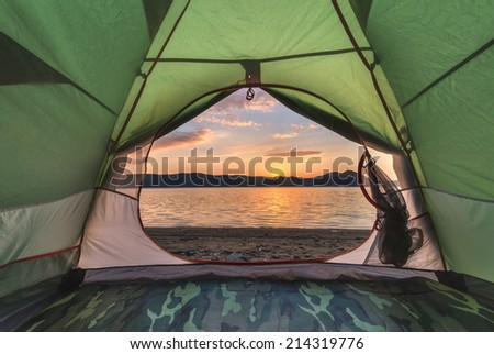 green tent on lake coastline closeup #214319776