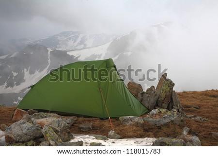 Green tent on mountain top, Retezat mountains, Romania #118015783