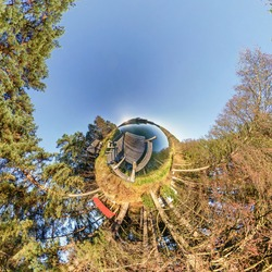 green tiny planet transformation of spherical panorama 360 degrees. Spherical abstract aerial view on forest. Curvature of space.