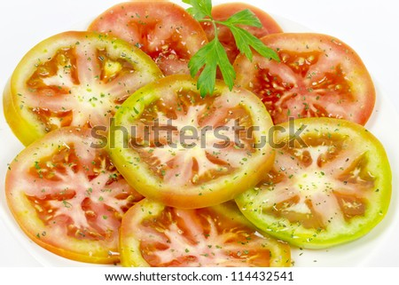 green tomato salad dressed with olive oil, salt and aromatic herbs