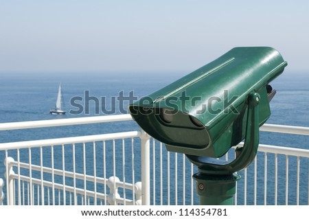 Green tourist telescope. Sea view and sky