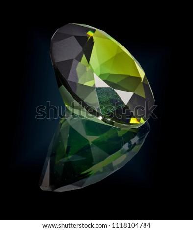 green tourmaline gem stone isolated on black background. #1118104784