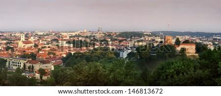 stock-photo-green-town-panorama-at-sun-rise-146813672.jpg