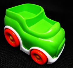 green toy car on black background