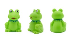 green toy frog in three positions on white background