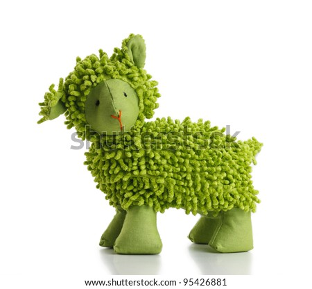 Green toy sheep on white background.