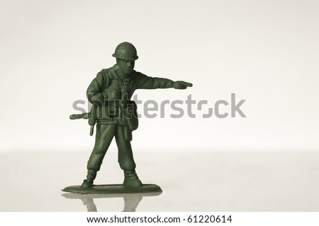green toy soldiers on white back ground