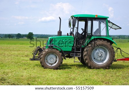 Green tractor in green field