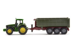 green tractor with semi-trailer isolated over white background