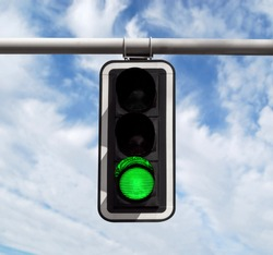 Green traffic light against blue sky background with Clipping Path