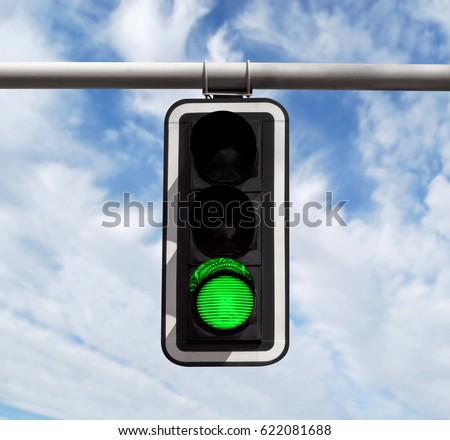 Green traffic light against blue sky background with Clipping Path #622081688