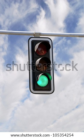 Green traffic lights against blue sky backgrounds with clipping path