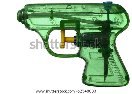 Green transparent plastic water pistol isolated on a white background