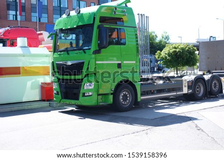 green truck for transporting goods, the theme of transport and industry  #1539158396