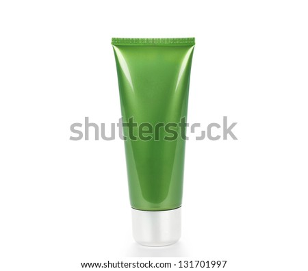 Green tube with cream isolated on white