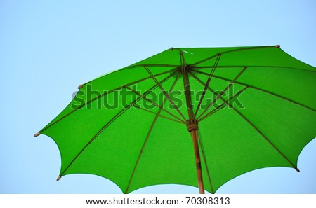 Green umbrella under sky