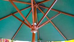 Green umbrella with natural wood bone