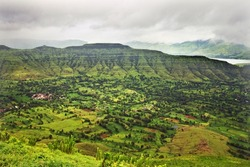 Green valley, aerial view of tropical highlands during rains