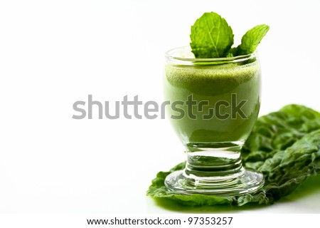 Green vegetable drink with fiber on a kale leaf