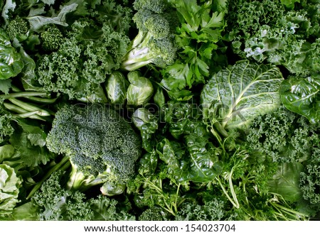 Green vegetables and dark leafy food background as a healthy eating concept of fresh garden produce organically grown as a symbol of health as kale swiss chard spinach collards broccoli and cabbage.