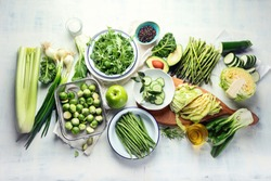 Green vegetables for healthy cooking. Vegetarian and vegan food. Healthy diet eating concept. Top view, flat lay