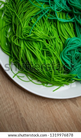 green vegetarian vermicelli. green vegetarian pasta. Vegetarian healthy food on white plate. green vegetarian pasta closeup photo #1319976878