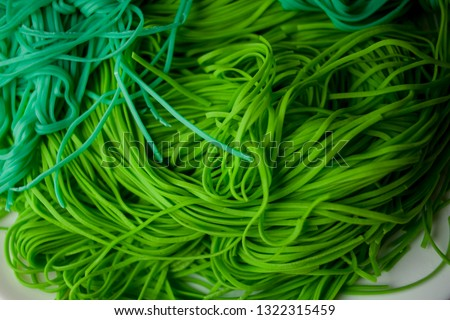 green vegetarian vermicelli. green vegetarian pasta. Vegetarian healthy food on white plate. green vegetarian pasta closeup photo #1322315459