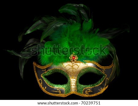 Green Venetian theater mask isolated on black