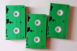 Green VHS video tapes on white   background. Obsolete technology.