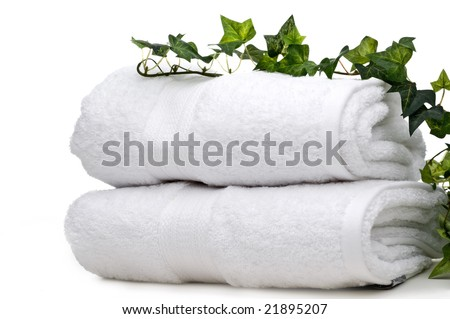 green vine on white towels