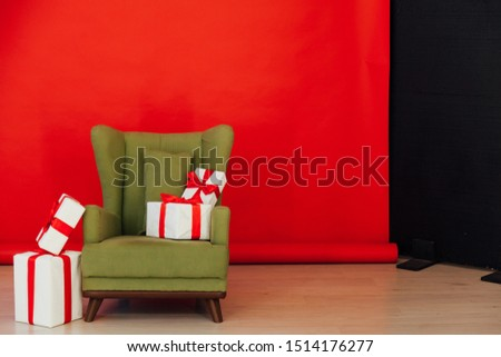 green vintage chair with gifts in the interior of the red room