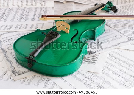 Green violin and musical score