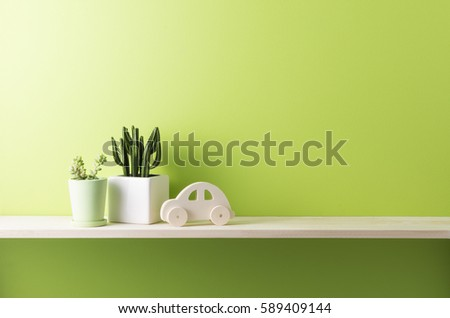 green wall and shelf