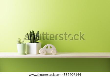 green wall and shelf