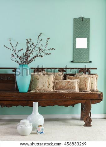 green wall asian interior decor with pillow