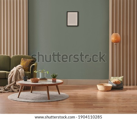 Green wall background, minimalist sofa, marble pattern wooden sofa, grey carpet, poster, lamp and frame.