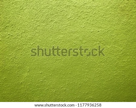 Green wall background. Painted rought concrete surface texture