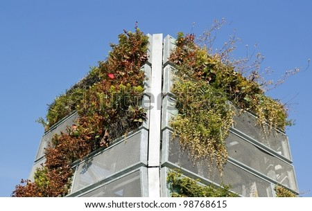 green wall of steel plate, urban art plant