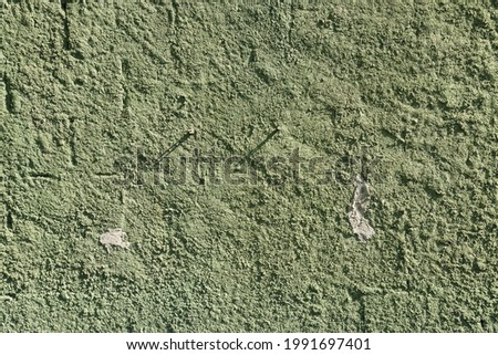 Green wall texture with reliefs. Closeup. Green background.
