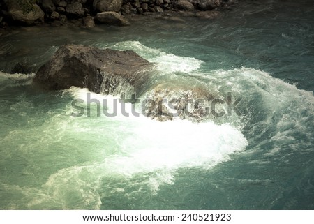 green water of the mountain river and a large stone #240521923