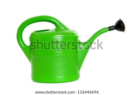 Green watering can in front of a white background
