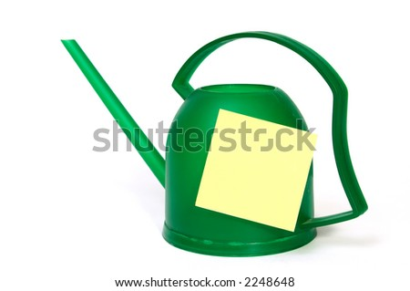 Green watering-can with blank yellow mark.