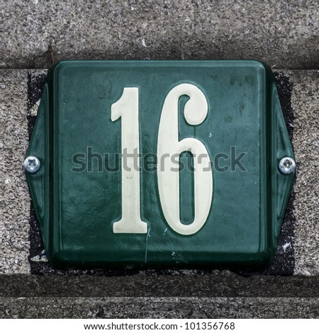 Green white enameled house number sixteen stock photo for Number 16 house