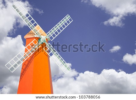 Green windmill tower with clear sky
