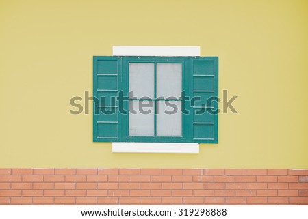 Free photos Open window with yellow curtain viewed from outside ...