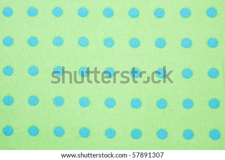 Green with blue polka dots seamless background pattern