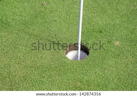 green with flag in the hole.