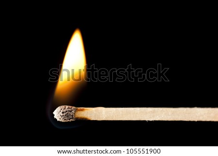 Green Wooden Matches on fire against black