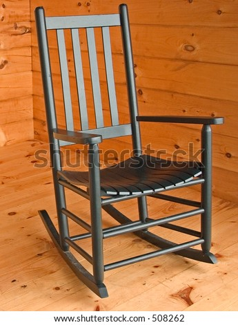 green wooden rocking chair on a knotty pine porch stock photo 508262